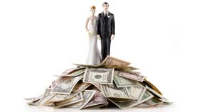 Heap of money with wedding cake topper